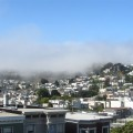 Foggy summer view looking south over Noe Valley from the deck